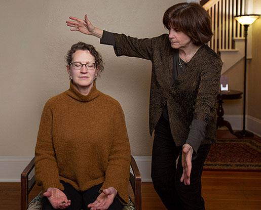 Madeline Hartman spiritual healing with client